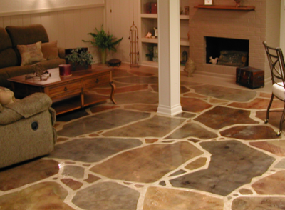 Decorative concrete basement floor with a multi-colored stone pattern.