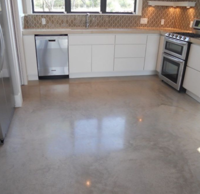 Stained and polished concrete kitchen floor.
