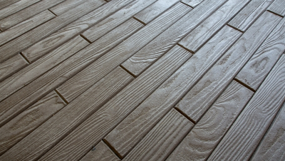 Interior concrete floor stamped with wood plank pattern.