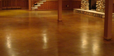 Stained and polished plain concrete basement floor.