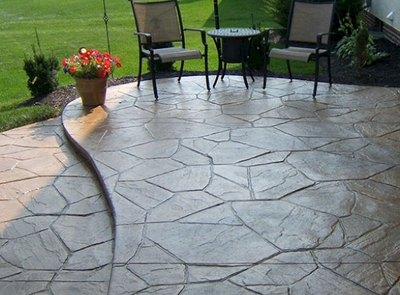Sandstone looking stamped concrete patio.