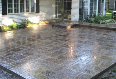 Dark brown polished stamped concrete patio.