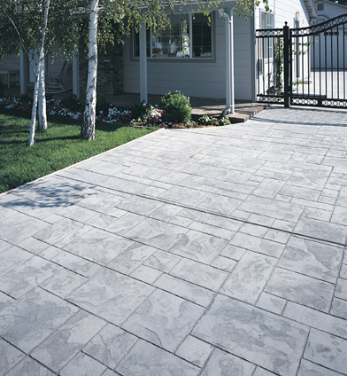 Gray brick style decorative concrete patio.