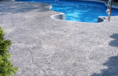 Texturized gray pool deck in Danbury.