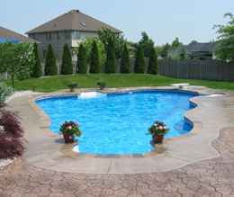 Stamped and stained concrete around a built in pool in Connecticut.