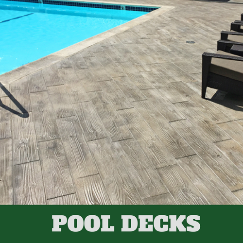 Danbury stamped concrete pool surround with a wood grain finish.